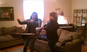 Leah with her violin instructor Emily