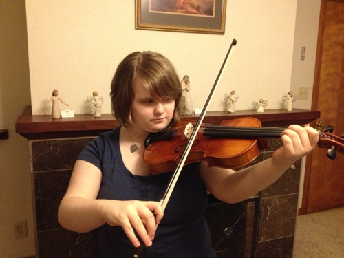 Leah with acoustic, German-made violin