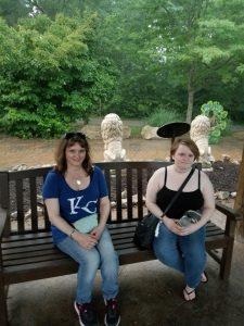 Me & Leah at lion exhibit in rain